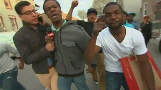 Baltimore protesters swarm CNN live report