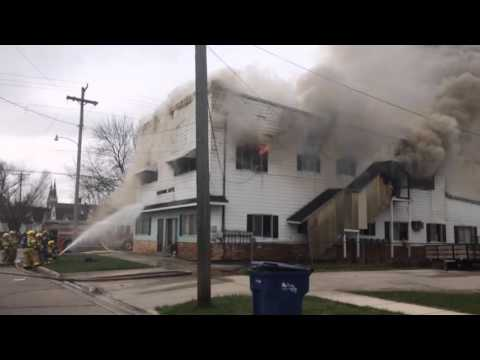 Firefighters battle a blaze at an apartment building in Bay City