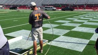 Tennessee crew painting checkerboard end zone for Battle At Bristol