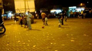 Kids playing football on the streets of Bombay