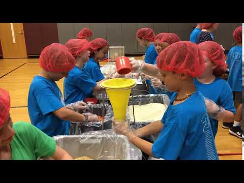 Brackett Elementary School students pack meals for Rise Against Hunger