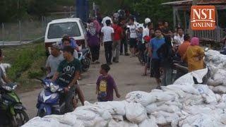 High tide phenomenon: Bunds break near Klang, 54 evacuated