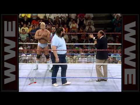 Earthquake is picked out of the crowd to assist Dino Bravo in a pushup contest: Superstars, Oct. 2,
