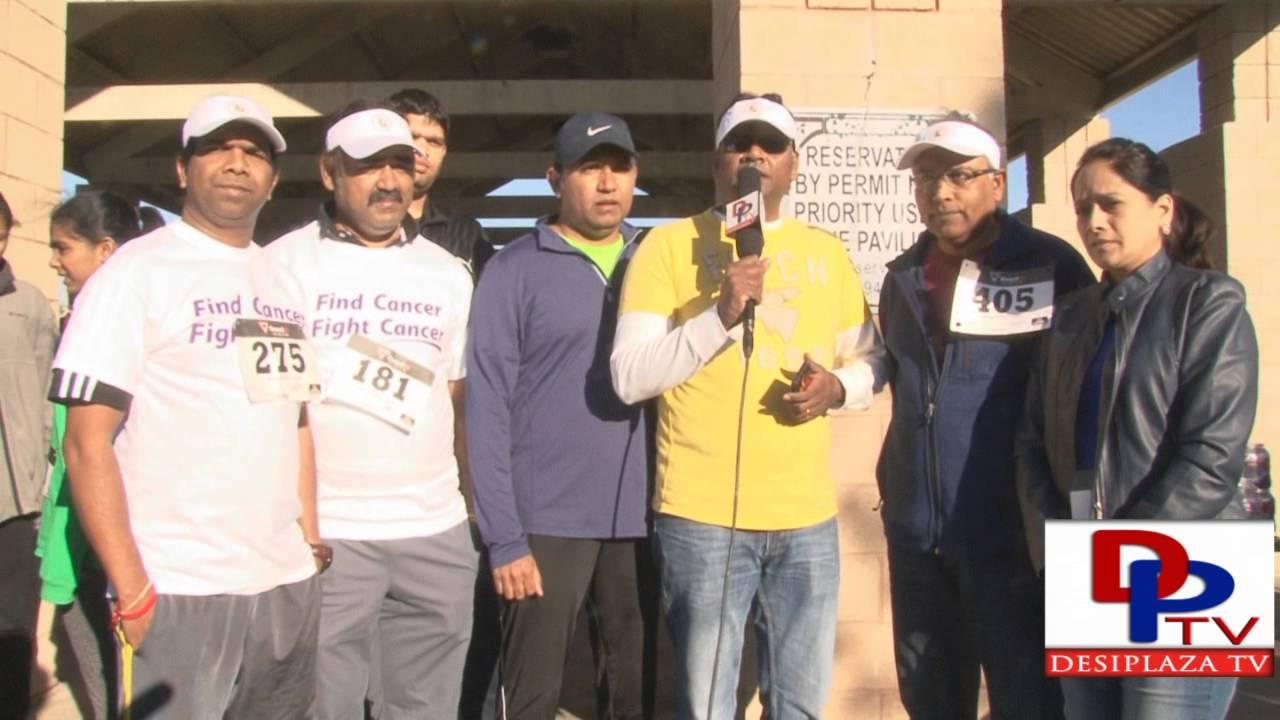 Volunteers of DATA 4th Annual 5k Run/Walk speaking to desiplaza in Dallas