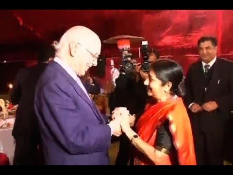 Sushma Swaraj meets Sartaj Aziz at a dinner function in Pakistan