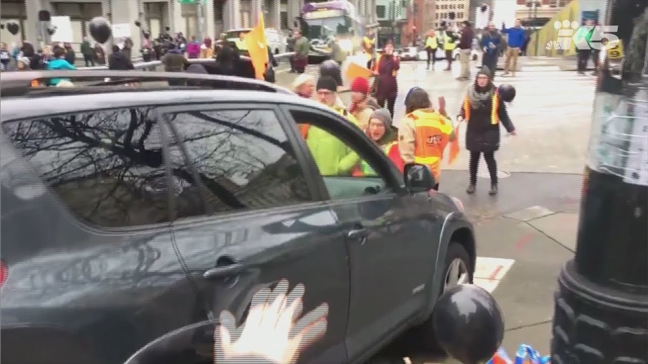 RAW: Angry driver barrels into Seattle protesters