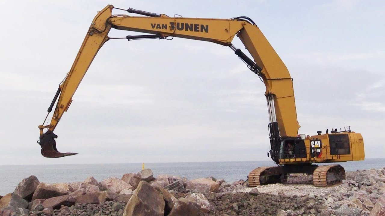 The Giant 220 Tons Custom Built Cat 6015B Triple Long Reach Excavator  Working On A Pier