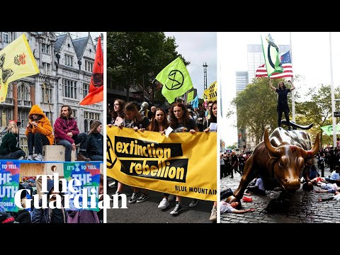 Extinction Rebellion activists glue themselves to DfT and Home Office