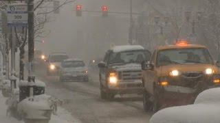 Massive winter storm slams Midwest, Northeast