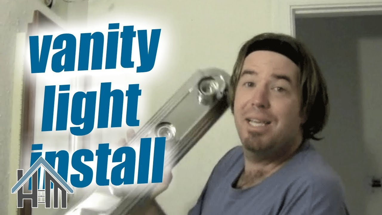 How To Replace A Vanity Light Fixture In Your Bathroom Easy