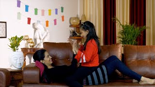 Young woman having fun with her six-year-old kid in the living room at home - family time