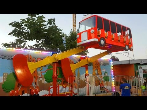 Outdoor playground for kids with flying bus. Funny video