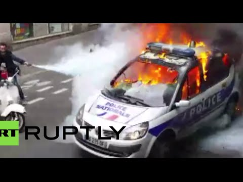 Police car smashed & set on fire during Paris protest