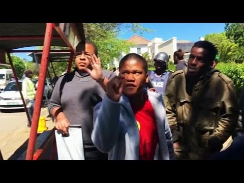 South African police fire rubber bullets at students protesting tuition costs at Rhodes University