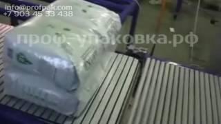 Групповая упаковка кошачьего наполнителя по 4 пакета упаковочной машиной ТМ 1 П полуавтомат