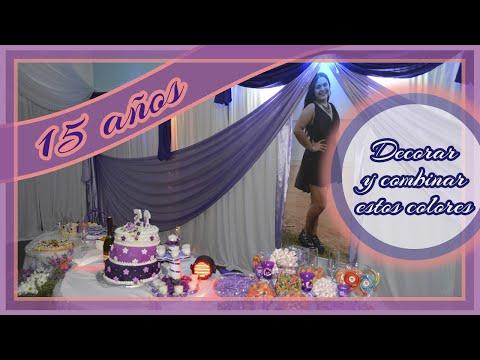 Decoración de fiesta de 15 años con telas añil, lila y blanco