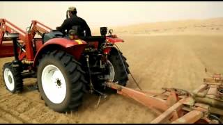 QLN farm tractor with front end loader and disc harrow in Saudi Arabia