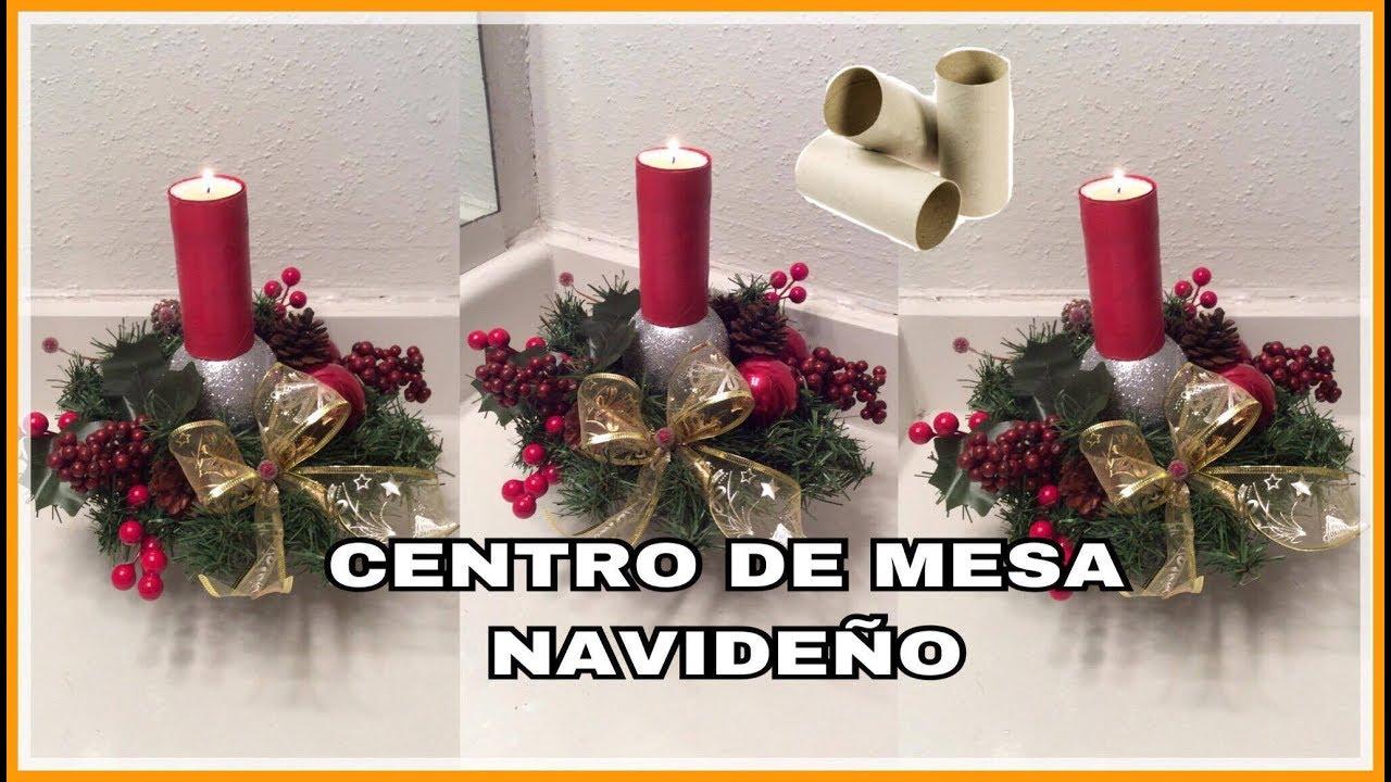 Centro de mesa navide o con rollos de papel higienico y for Adornos con plantas de nochebuena