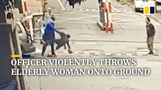 Download Urban management officer in China violently throws elderly woman onto ground