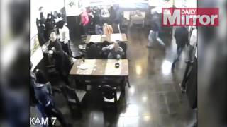 Watch moment masked gang storm restaurant   but one man isn't going to let it ruin his lunch(Watch moment masked gang storm restaurant - but one man isn't going to let it ruin his lunch Is this guy hard as nails or just hungry? This 70-second clip shows ..., 2014-11-18T15:20:22.000Z)