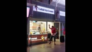 Turkish ice cream man in Las Vegas dancing for customers (girls)