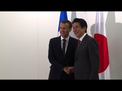 Emmanuel Macron meets Shinzo Abe in Saint-Petersburg