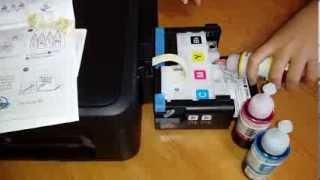 무한잉크 프린터 주입하는 모습
