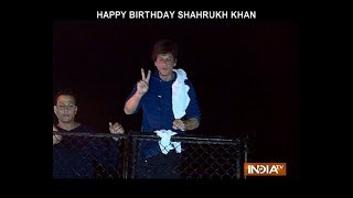 Shah Rukh Khan greets fans outside Mannat at midnight on birthday