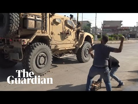 Syrian residents pelt retreating US troops with food and insults