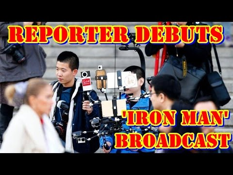High tech reporter debuts 'iron man' broadcast devices during Two Sessions