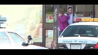 Denver Police Sniper shoots man holding hostage at gunpoint.