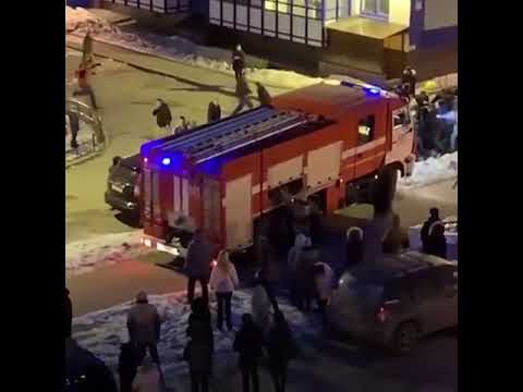 People drag cars out of the way of firetruck responding to emergency