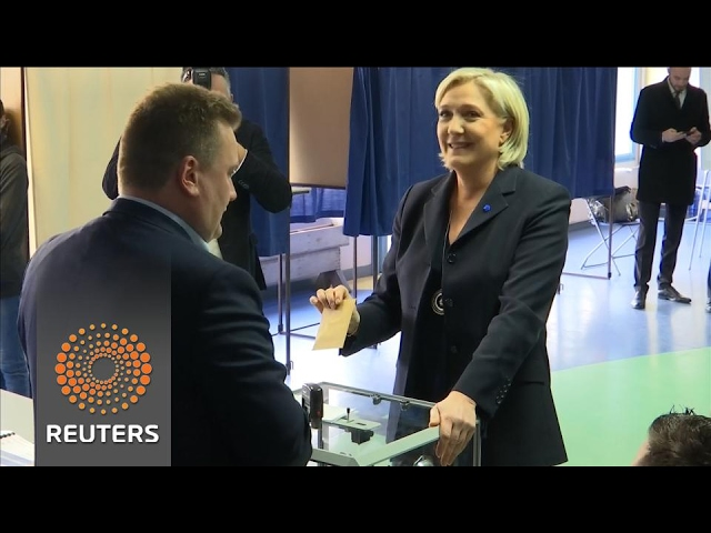 Marine Le Pen casts her vote in close presidential election