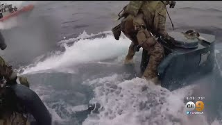 WATCH: Coast Guard Officers Leap Onto Moving Drug Sub