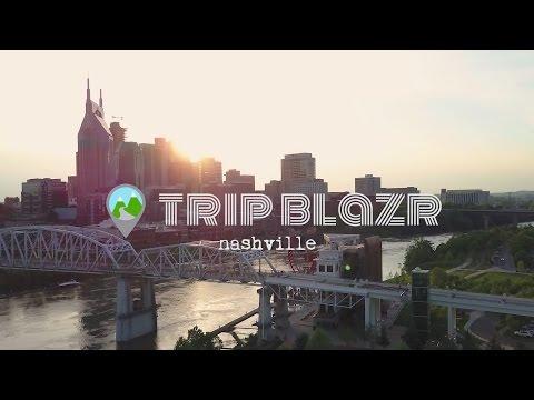 Nashville pedestrian bridge, riverfront park, and downtown views at sunset.