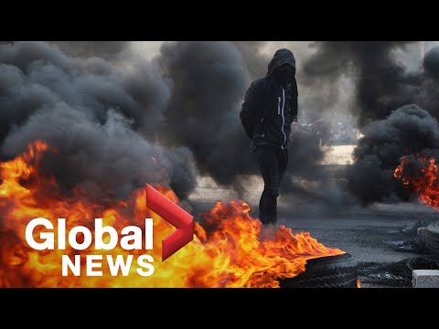 Demonstrators block streets in Iraq during anti-government protests