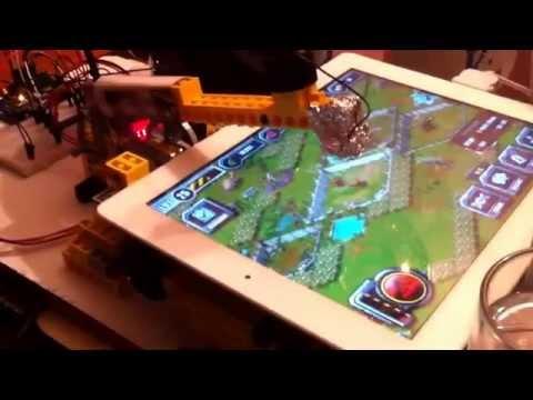 Lego robot plays freemium iPad games while creator sleeps
