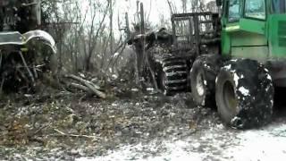 John Deere 1710D forwarder in Snow