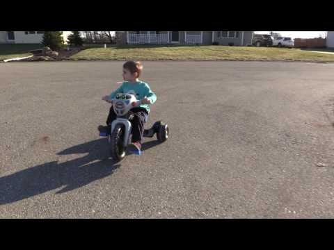 Jaxson Riding Batman Tricycle