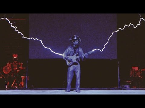 Iron Man by Black Sabbath played on 2 Tesla coils , a midi guitar and a drumming robot