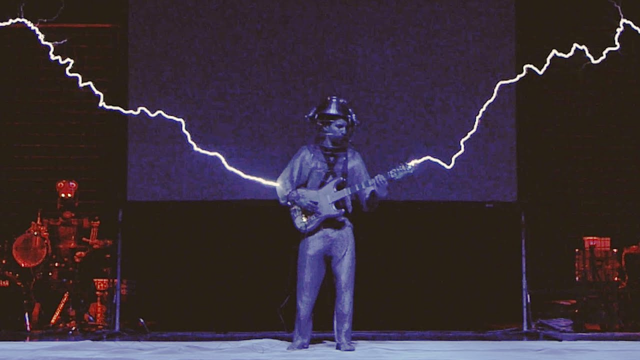 iron man with musical tesla coils a robot and midi guitar