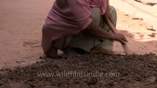 Woman breaking the mud