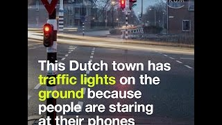 Video This Dutch town has traffic lights on the ground because people are staring at their phones download MP3, 3GP, MP4, WEBM, AVI, FLV Oktober 2017