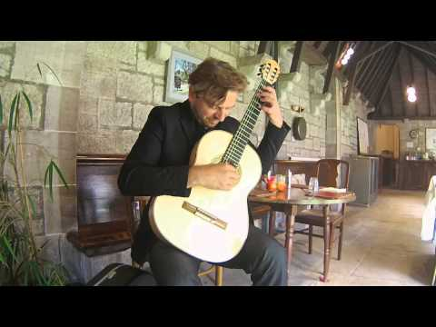 Marcin Dylla playing a spruce/maple guitar by James Lister