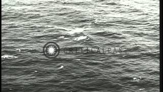 German submarine U-2513 submerged in water with submarine snorkeling in the Atlan...HD Stock Footage