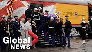 Bush funeral: '4141' train pulls away carrying 41st president's casket