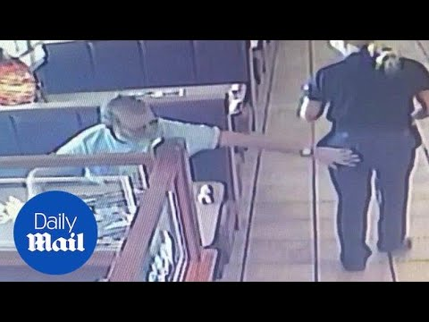 Shocking CCTV video shows moment customer slaps waitress on backside - Daily Mail