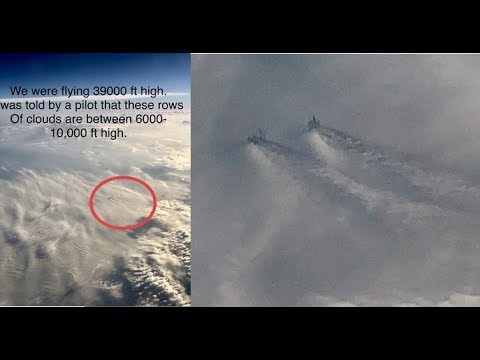 Airplane passenger photographs Huge Structure on the clouds at 10,000 feet High