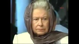 Queen Elizabeth II listening to a recitation of the Quran