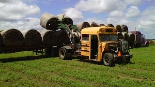 School Bus Turned into Hay Bale Loader on South Dakota Farm(Video of South Dakota man's custom reversed 1988 IH school bus with Artsway loader in action loading large round hay bales in farm field near Highmore, SD., 2014-09-25T11:07:13.000Z)